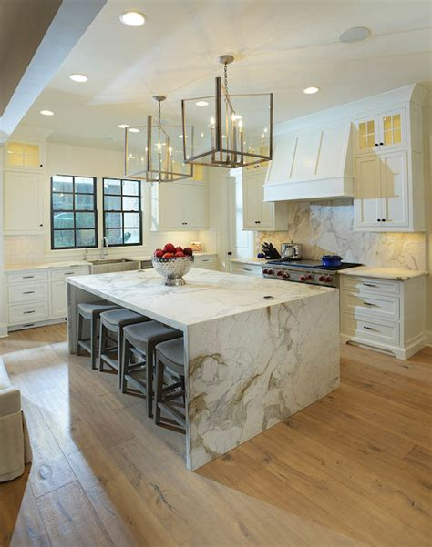 marble kitchen island marble waterfall island transitional kitchen lori paranjape