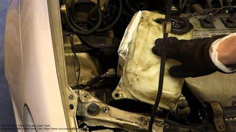 replace washer fluid tank toyota corolla years