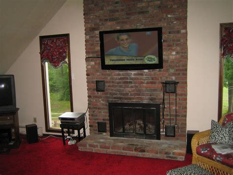 durham ct tv mounted above fireplace on brick looks