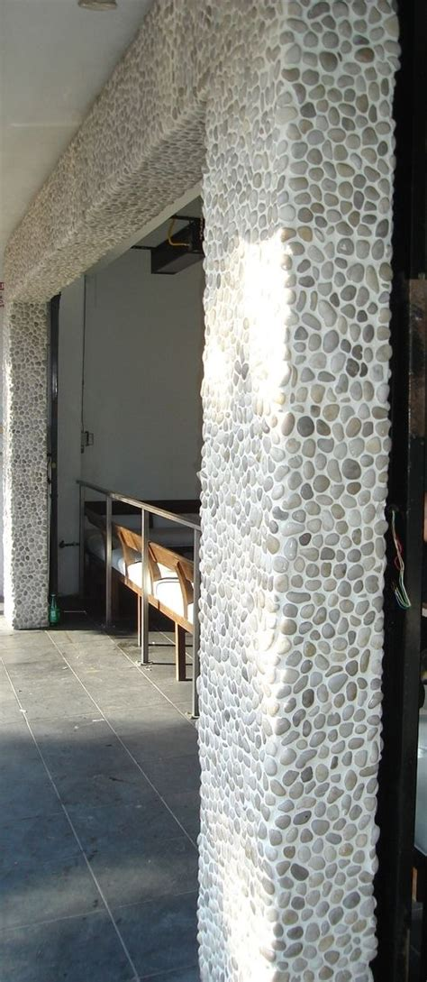 river rock tile on column installation detail   interior