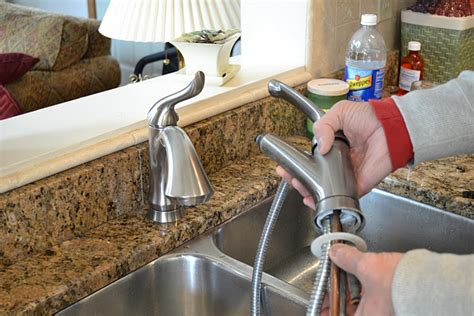 change a kitchen faucet how to replace a kitchen sink faucet