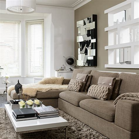 beige sofa living room neutral modern living room with beige sofa and mirror
