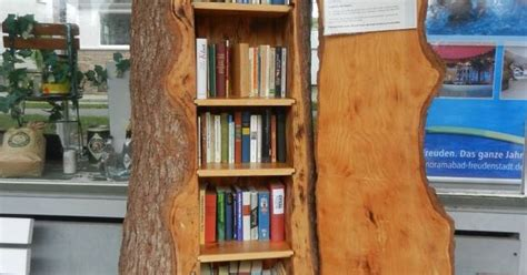 a bookshelf shaped like a tree trunk what a idea