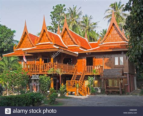 buy thai spirit house carved wood traditional thai house and small spirit house in front stock photo royalty free