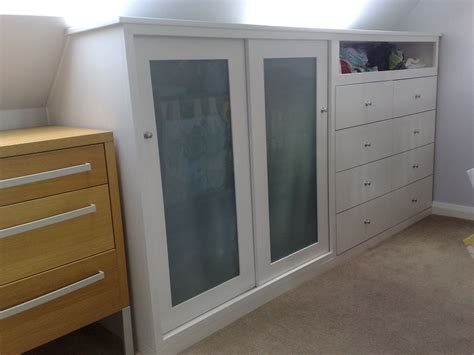 a half wardrobe with drawers designed to fit an eave