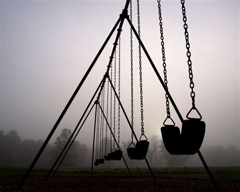 empty swing playground shot at a local metro park on a very foggy