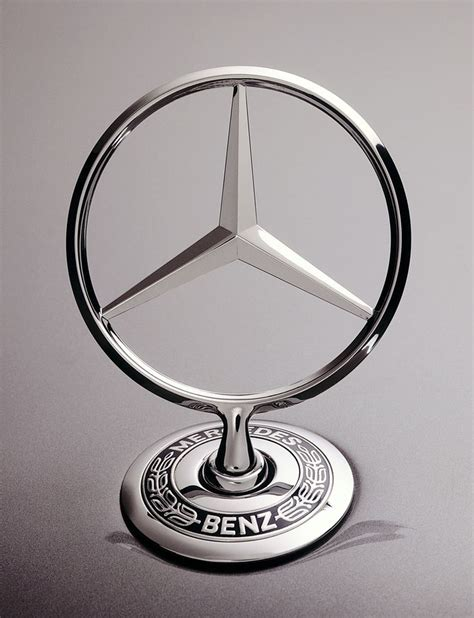 car mercedes logo the star as a radiator emblem emerges upwards from the
