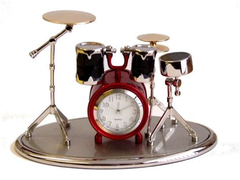 clocks with a theme drum kit and piano clocks