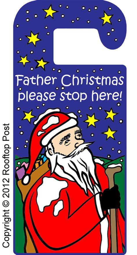 printable christmas door hangers door hanger father christmas please stop here rooftop