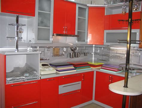 pretty chrome and red kitchen cabinets with modern