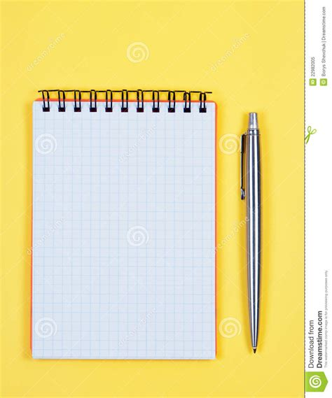 Softcase Notebook 10 Yellow Sign notebook with pen on yellow background stock image