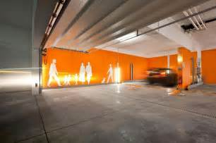 amusing parking garage designs with orange wall painting design and structure transit and parking university of