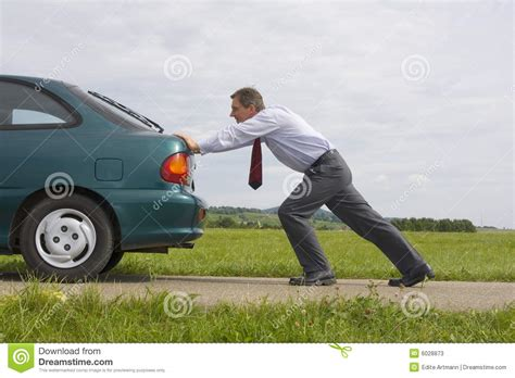 Is Pushing by Businessman Pushing A Car Stock Image Image Of Empty