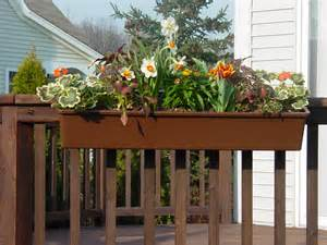 hanging planter boxes for decks balconies with various flower plants painted with dark brown