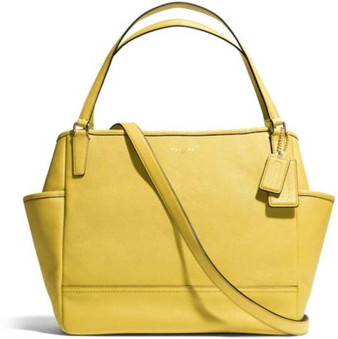 coach baby bag tote in saffiano leather in yellow light gold saffron lyst