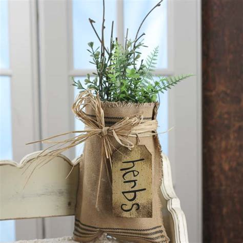 artificial herb and twig filled burlap bag wall