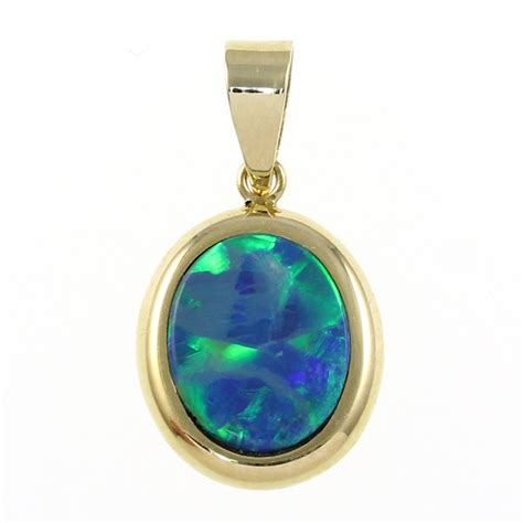 9ct yellow gold oval bezel set blue opal pendant