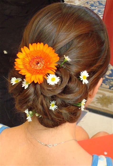beach wedding hairstyle updo  fresh flowers  orange