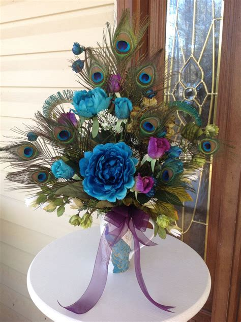 silk flower centerpiece peacock feather arrangement