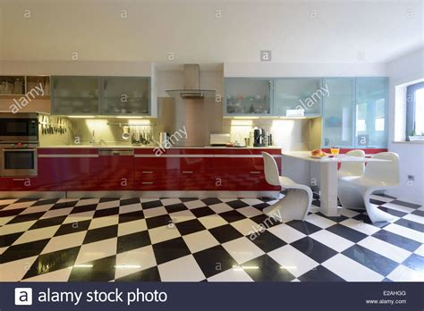 Bathroom Interior With Brown And Beige Tiles Royalty Free modern kitchen interior with checkered floor stock photo