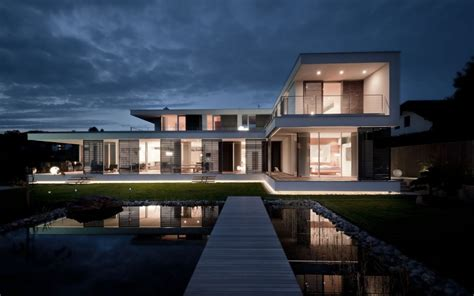 Contemporary Architecture Design by A Better Version Of An L Shaped Villa Hovering Above The
