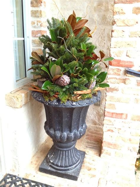 Winter Gardening In Texas - winter planter spruce magnolia cinnamon stick bundles frosted pinecones by bliss blooms in