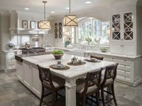 Kitchen white cabinets with island table linen storage drawers and