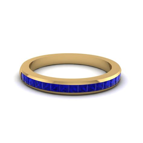 Set Cenel channel set princess cut band with blue sapphire in 14k