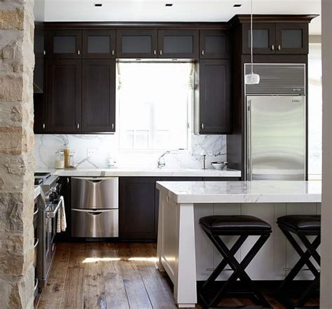 modern kitchen dark cabinets modern kitchen with stone walls white island and dark
