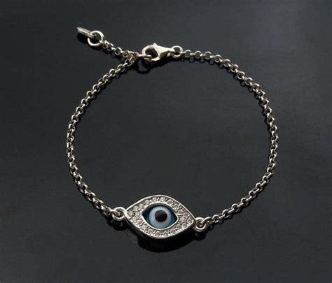 Tasseled Triangle Earrings black silver evil eye triangle drop earrings evil