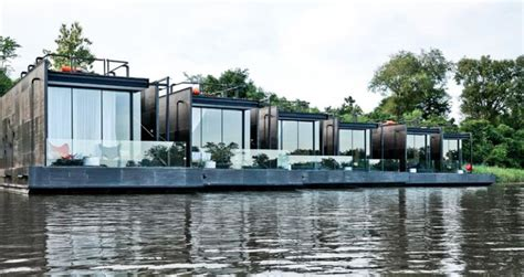 these floating cabins overlook river kwai in thailand