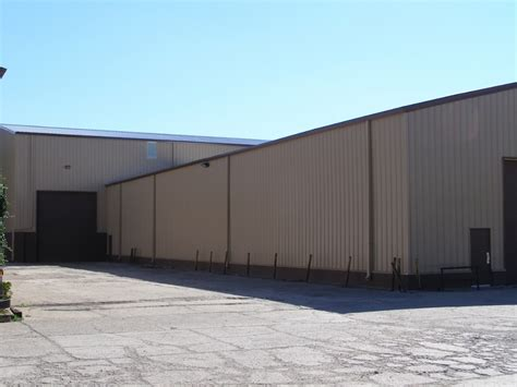 haggetts newly painted building haggetts aluminum insulation retrofit commercial and industrial metalguard