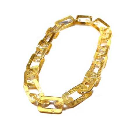 home design studio chain link wall décor acrylic gold chain link necklace by jennifer merchant