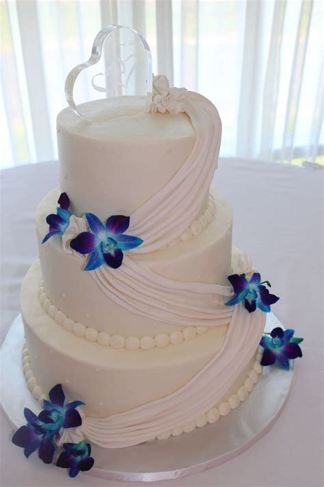Buttercream Wedding cake with a fondant swag and fresh