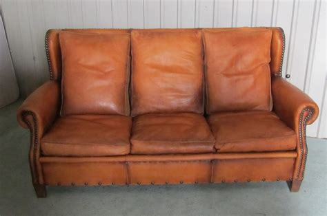 shabby leather sofa a french shabby leather art deco wing back sofa antiques