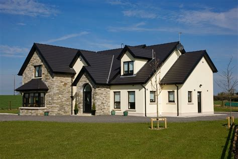 types of roof tiles ireland a roofer assessing an of