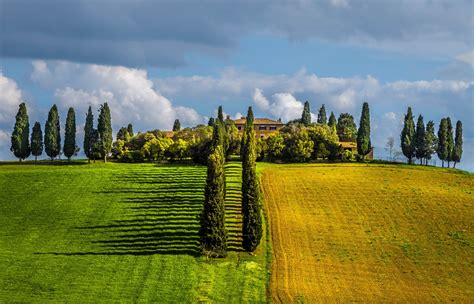 tuscany italy field trees villages clouds spring green
