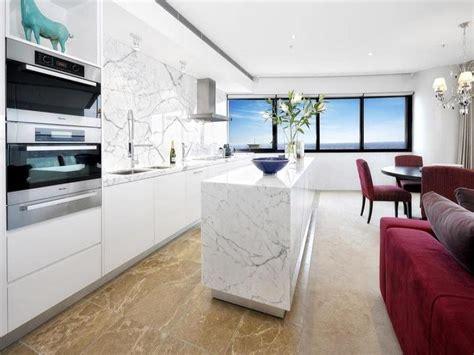 cucina di marble modern island kitchen design using marble kitchen photo