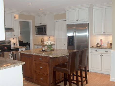 contrasting stained wood and white painted cabinets