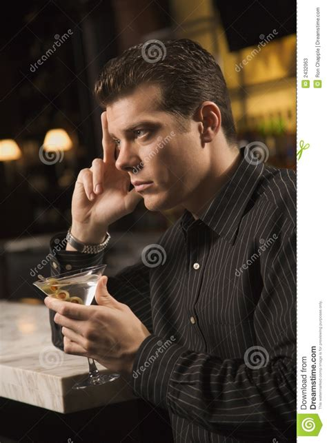 man holding martini man drinking martini stock photos image 2432063