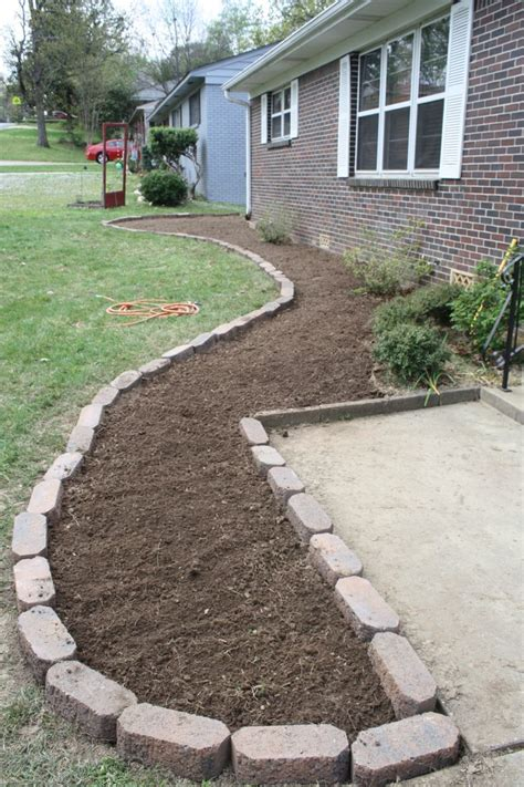 building a flower bed building and filling a flower bed remodeling a 100 year