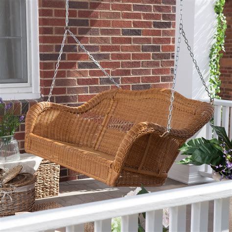 coral coast casco bay resin wicker porch swing honey