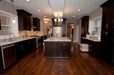 kitchen floors and cabinets espresso kitchen cabinets with wood floors fair laundry