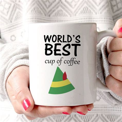 world s best cup of coffee mug elf movie will ferrell sign world s best cup of coffee elf mug by lucky roo