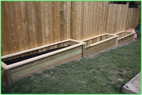 Raised Garden Bed Fence Ideas Build Raised Garden Bed Along Fence The Best Of Bed