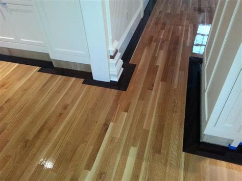 rift sawn white oak flooring with 5 quot walnut border in
