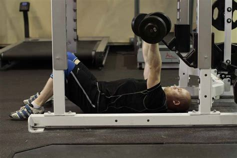dumbbell bench press on the floor dumbbell floor press exercise guide and video