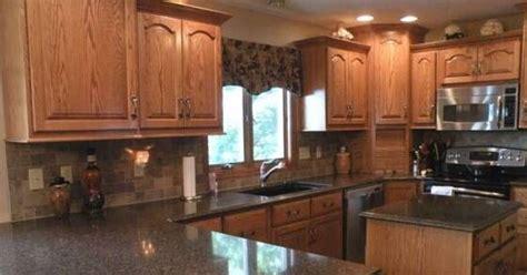 quartz countertops with oak cabinets pictures of oak cabinets with quartz countertops