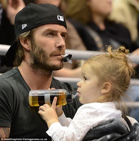 beckham tattoo for his daughter david beckham larks around with daughter harper at hockey