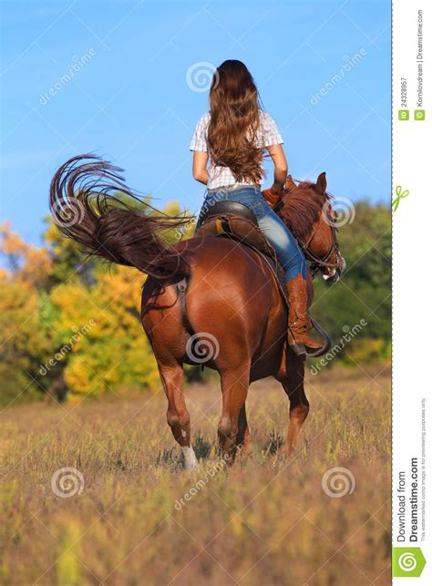 commercial girl riding horse woman in blue jeans riding a horse stock image image of